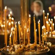 Burning candles in thechurch, sacred fire — Stock Photo #73325611