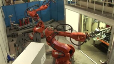 Industrial Robots on an Assembly Line — Stock Video