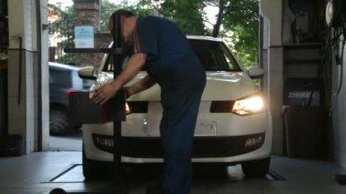 Car Repair Mechanic Adjusting Headlights — Stock Video