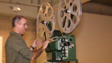 Film Technician Projecting 16mm Film — Stock Video
