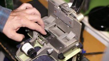 Film Technician Splicing 35mm Film — Stock Video