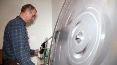 Film Technician Rewinding 35mm Film — Stock Video