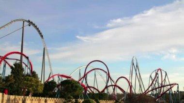 Huge Roller Coasters at an Amusement Park — Vídeo de Stock