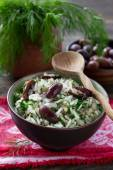 Rice with olives and fresh herbs — Stock Photo