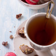 French Macarons with cup of tea — Stock Photo #67893703