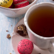 French Macarons with cup of tea — Stock Photo #67893711