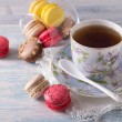 French Macarons with cup of tea — Stock Photo #67893725