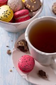 French Macarons with cup of tea — Stock Photo
