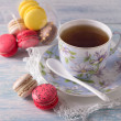 French Macarons with cup of tea — Stock Photo #68523401
