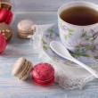 French Macarons with cup of tea — Stock Photo #68523381