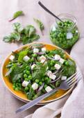 Salad with green peas, beans, red onion and feta cheese — Stock Photo