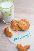 """Shortbread cookie and a glass of milk for Breakfast. Note """"good morning"""" on the wooden table. — Stock Photo"""