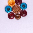 Old colored buttons for background.Laid out in the shape of a flower. — Stock Photo #65470579