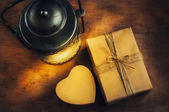 Gifts on Valentine's Day in cardboard boxes. A kerosene lamp on the wooden table. — Stock Photo