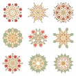 Set of nine floral circular design elements — Stock Vector #56067323