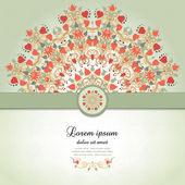 Vector card with round floral pattern and ribbon. — Stock Vector