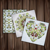 Set of banners with floral patterns on wood background — Stock Vector