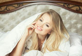 Good morning concept. Beautifull young woman in luxury comfortab — Stock Photo