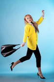 Portrait of blond model in fashion yellow jacket and black denim — Stock Photo