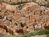 BryceCanyon is distinctive due to its geological structures, called hoodoos, formed from wind, water, and ice erosion of the river and lakebed sedimentary rocks these are eerie and often whimsical — Stock Photo