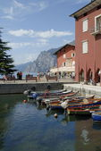 Torbole is situated on the extreme north-western appendix of the Baldo chain in the Trento region of Italy. and it is set as an amphitheatre on Lake Garda. — Stock Photo