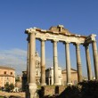 The ancient Forum with its temples and monuments is in the middle of the city of Rome Italy — Stock Photo #55244471