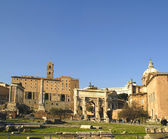 The ancient Forum with its temples and monuments is in the middle of the city of Rome Italy — 图库照片