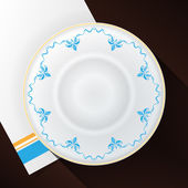 White plate with a blue pattern. — Stock Vector