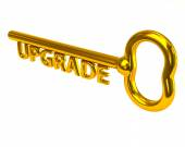 Golden key with word upgrade — Stock Photo