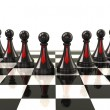 White pawns with red ties on desk — Stock Photo #66393967