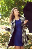 Girl with an umbrella — Stock Photo