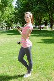 Fitness girl doing exercise with lightweight dumbbells  — Foto Stock