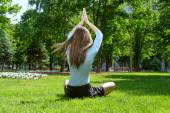 Yoga girl is meditating in lotus position  — 图库照片