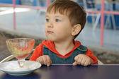 Boy has eaten all the ice cream — Stock Photo