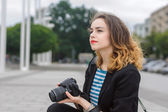 Woman tourist looking thoughtfully away — Stock Photo