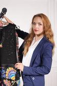 Woman in formal wear chooses black shirt — Stock Photo
