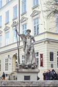 An ancient statue of Neptune in the central square of Lviv - Mar — Stock Photo