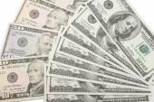 Pozadí s peníze. amerických dolarů izolovaných na bílém pozadí — Stock fotografie