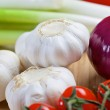 White garlic and purple onion on a wooden board — Stock Photo #58067473