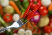 Red hot chilli peppers on fork — Stock Photo