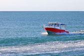 Red motor boat floating in the ocean or sea — Foto de Stock