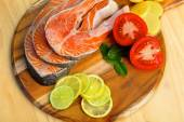 Delicious  portion of fresh salmon fillet with vegetables and herbs — Stock Photo