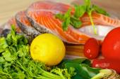 Delicious  portion of fresh salmon fillet with lemon and basil — Foto de Stock