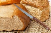 White bread loaf on wooden table — Stock Photo