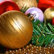 Variety of christmas balls on green fir-tree branch — Stock Photo #59393547