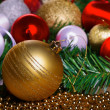 Variety of christmas balls on green fir-tree branch — Stock Photo #59394209
