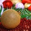 Variety of christmas balls on green fir-tree branch — Stock Photo #59394851