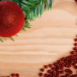 Christmas ball and red beads on wooden background — Stock Photo #59396607
