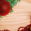 Christmas ball and red beads on wooden background — Stock Photo #59397327