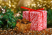 Christmas present boxes with yellow beads — Stock Photo